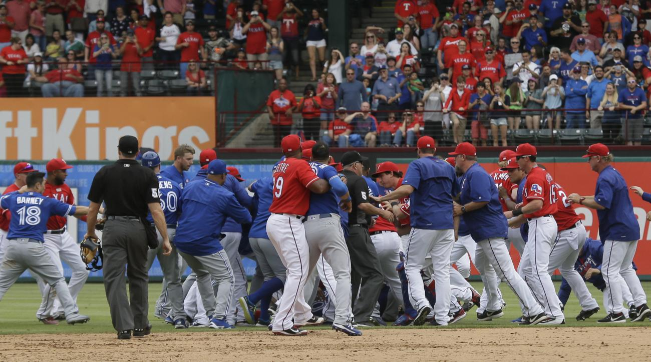 The Toronto Blue Jays and Texas Rangers have a benches clearing brawl during the eighth inning of a baseball game in Arlington, Texas, Sunday, May 15, 2016. (AP Photo/LM Otero)