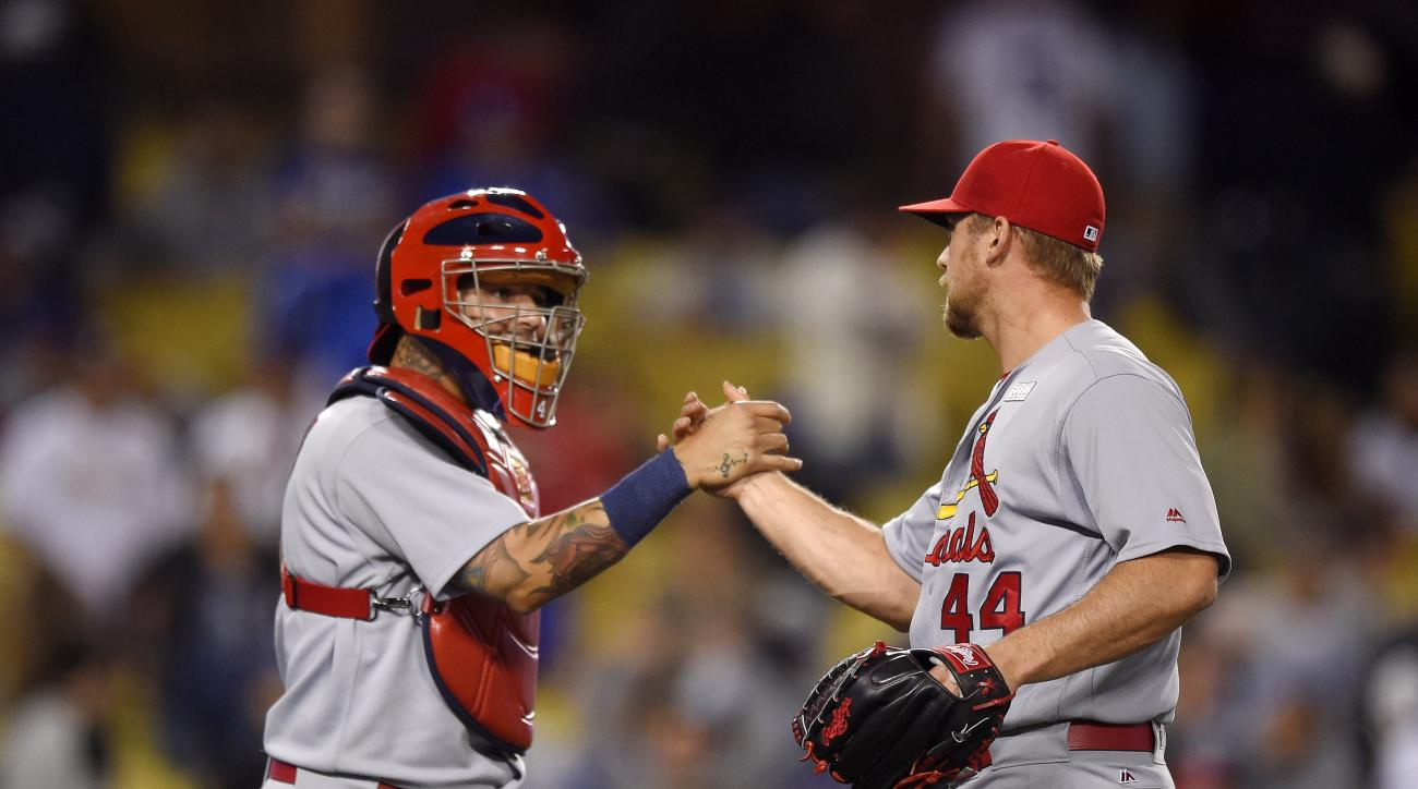 St. Louis Cardinals catcher Yadier Molina, left, and relief pitcher Trevor Rosenthal congratulate each other after the Cardinals defeated the Los Angeles Dodgers 5-2 in a baseball game, Sunday, May 15, 2016, in Los Angeles. (AP Photo/Mark J. Terrill)