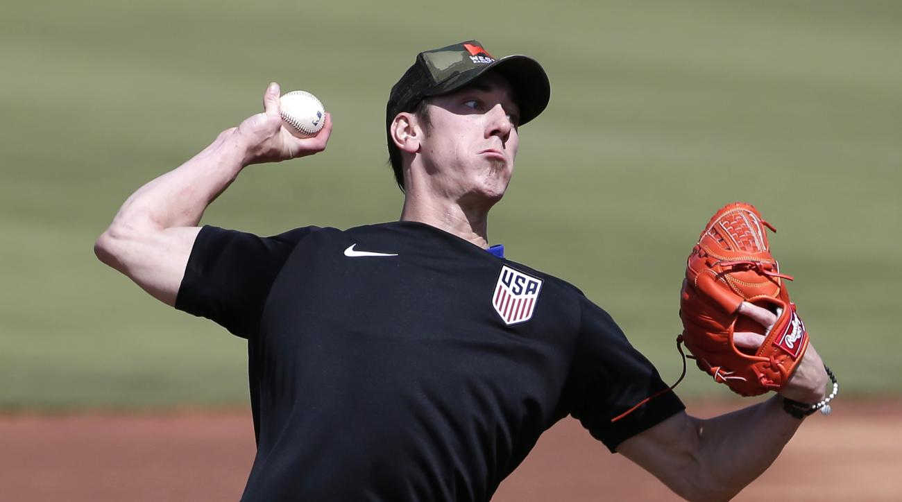 FILE - This May 6, 2016 file photo shows pitcher Tim Lincecum throwing for MLB baseball scouts at Scottsdale Stadium in Scottsdale, Ariz. The Los Angeles Angels are closing in on a deal to sign the two-time Cy Young Award winner, a free agent trying to co