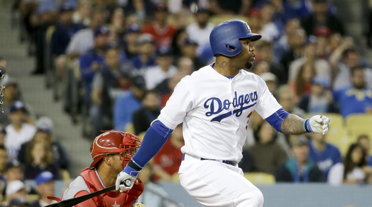 Los Angeles Dodgers' Carl Crawford watches his RBI-single against the Los Angeles Angels during the second inning of a baseball game in Los Angeles, Monday, May 16, 2016. (AP Photo/Chris Carlson)