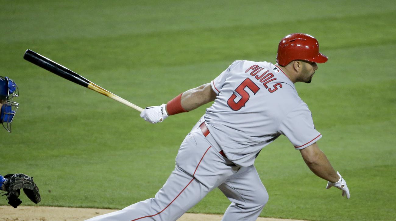 Los Angeles Angels' Albert Pujols watches his Two-RBI single against the Los Angeles Dodgers during the seventh inning of a baseball game in Los Angeles, Monday, May 16, 2016. (AP Photo/Chris Carlson)