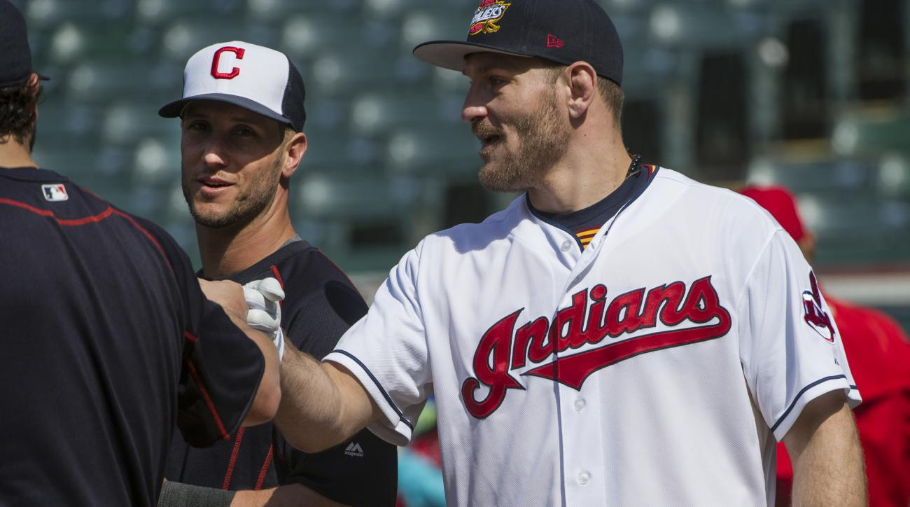 UFC Heavyweight Champ Stipe Miocic, right, a Cleveland native, talks with Cleveland Indians catcher Yan Gomes, left, after taking batting practice with the Indians, before a baseball game against the Cincinnati Reds, in Cleveland, Tuesday, May 17, 2016. M