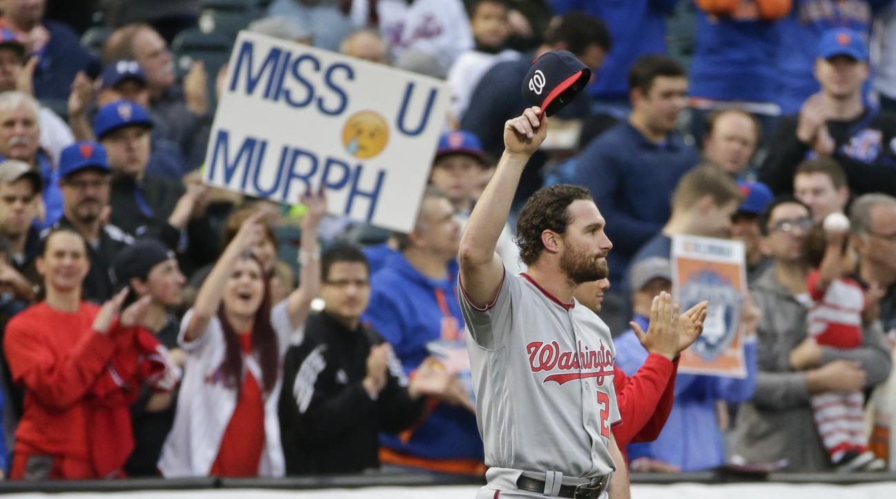 Washington Nationals' Daniel Murphy waves to fans during a video tribute to him before the Nationals' baseball game against the New York Mets on Tuesday, May 17, 2016, in New York. (AP Photo/Frank Franklin II)