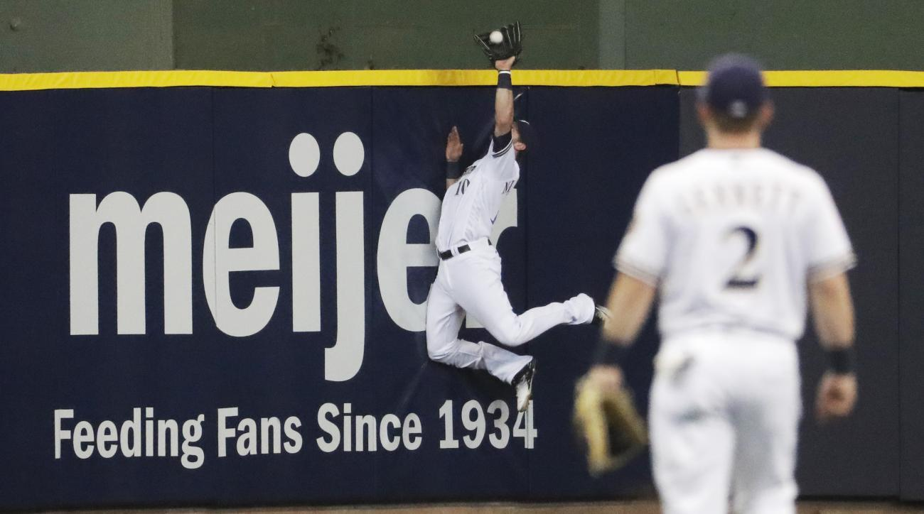 Milwaukee Brewers center fielder Kirk Nieuwenhuis makes a catch at the wall on a ball hit by Chicago Cubs' Kris Bryant during the first inning of a baseball game Tuesday, May 17, 2016, in Milwaukee. (AP Photo/Morry Gash)