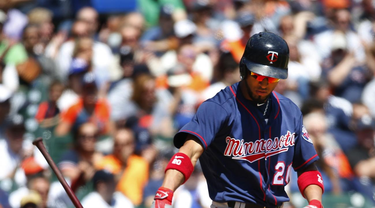 Minnesota Twins' Eddie Rosario throws his bat down after striking out against the Detroit Tigers in the fourth inning of a baseball game in Detroit, Wednesday, May 18, 2016. (AP Photo/Paul Sancya)
