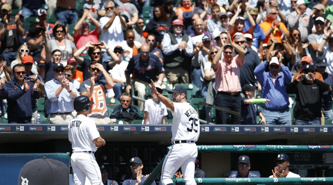 Detroit Tigers pitcher Justin Verlander acknowledges the crowd after his 2,000th career strikeout in the fourth inning of a baseball game against the Minnesota Twins in Detroit, Wednesday, May 18, 2016. (AP Photo/Paul Sancya)