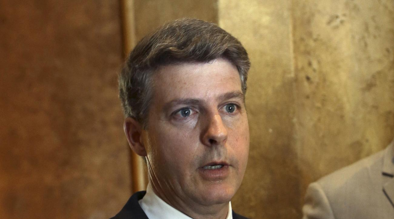 New York Yankees owner Hal Steinbrenner speaks with reporters during a meeting of MLB owners, Wednesday, Jan. 20, 2016, in Coral Gables, Fla. The two-day meeting of baseball owners is expected to include updates on stadium security, preventing takeout sli