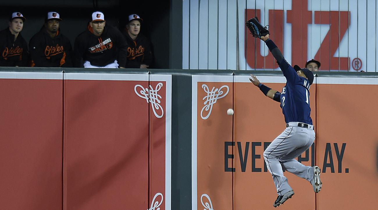 Seattle Mariners center fielder Leonys Martin leaps and misses a long fly ball hit by Baltimore Orioles' Matt Wieters in the fourth inning of a baseball game, Wednesday, May 18, 2016, in Baltimore. Wieters earned a RBI and a double on the play. (AP Photo/