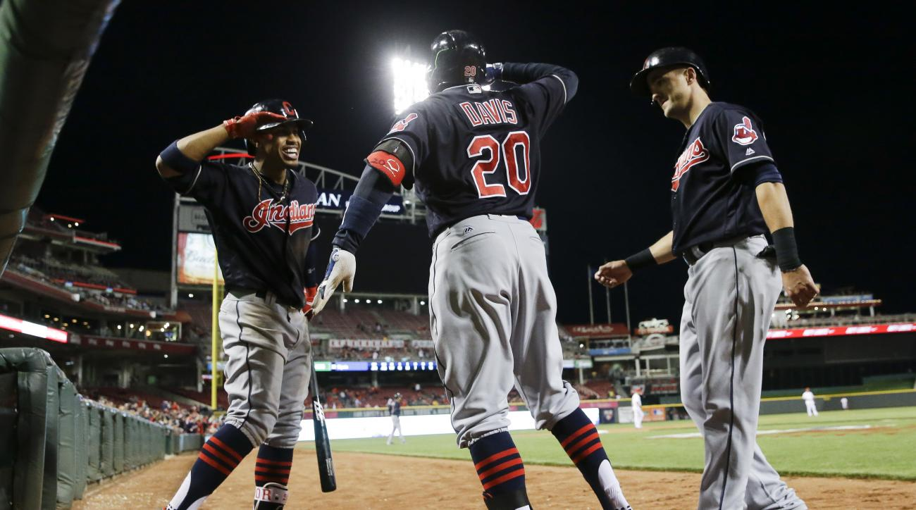 Cleveland Indians' Rajai Davis (20) celebrates with teammates after hitting a game-tying two-run home run off Cincinnati Reds relief pitcher Tony Cingrani during the ninth inning of a baseball game, Wednesday, May 18, 2016, in Cincinnati. (AP Photo/John M