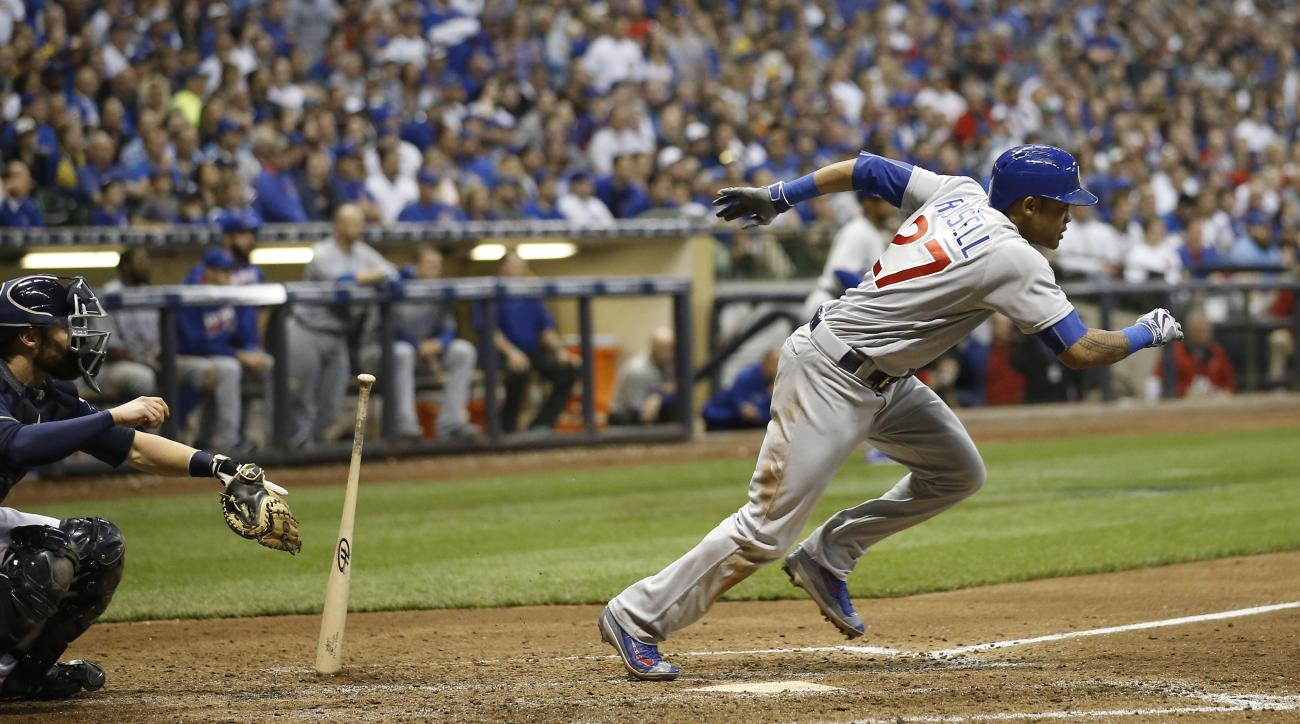 Chicago Cubs' Addison Russell hits an RBI ground ball to second during the ninth inning of a baseball game against the Milwaukee Brewers Wednesday, May 18, 2016, in Milwaukee. (AP Photo/Morry Gash)