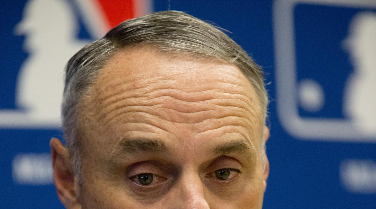 Baseball Commissioner Rob Manfred speaks to reporters during a news conference at Major League Baseball headquarters in New York, Thursday, May 19, 2016. (AP Photo/Mary Altaffer)