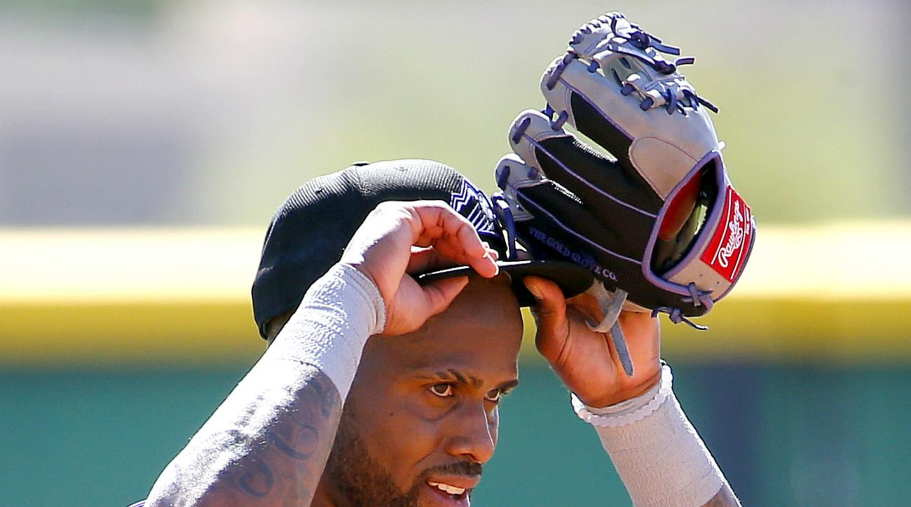 Colorado Rockies' Jose Reyes runs drills during an extended spring training, Thursday, May 19, 2016, at the Rockies' facility in Scottsdale, Ariz. Reyes was working out for the first time after being suspended under MLB domestic-violence policy. (AP Photo