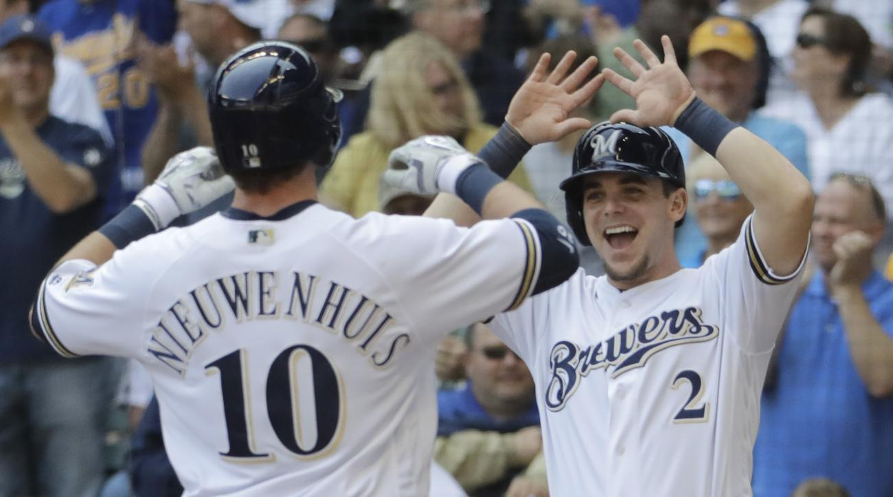 Milwaukee Brewers' Scooter Gennett (2) congratulates Kirk Nieuwenhuis (10) on his two-run home run during the sixth inning of a baseball game against the Chicago Cubs Thursday, May 19, 2016, in Milwaukee. (AP Photo/Morry Gash)