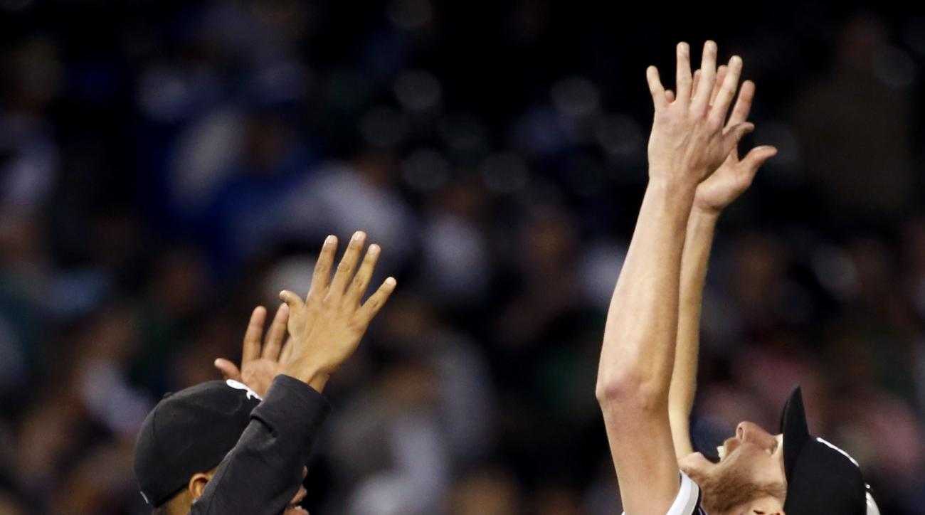 Chicago White Sox's Chris Sale, right, and Jose Quintana celebrate after the White Sox defeated the Houston Astros 2-1 in a baseball game Thursday, May 19, 2016, in Chicago. (AP Photo/Nam Y. Huh)