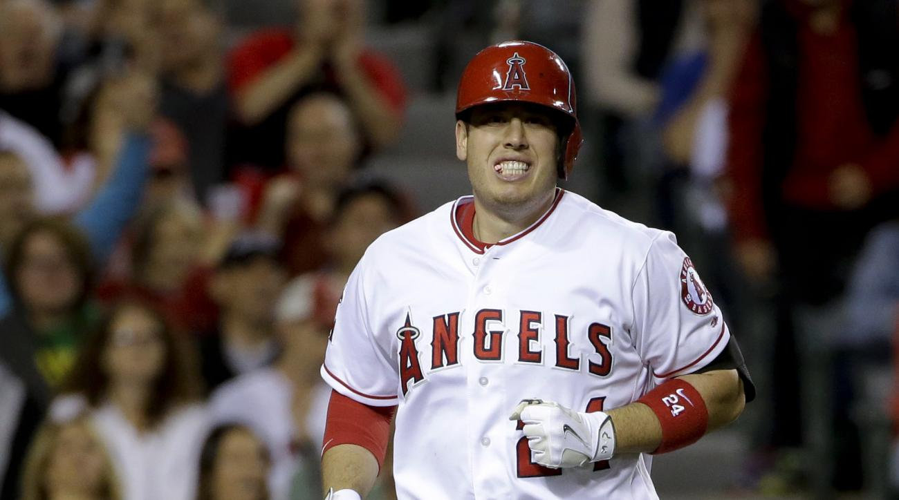 Los Angeles Angels' Kole Calhoun reacts after getting hit by a pitch during the fifth inning of a baseball game against the Los Angeles Dodgers in Anaheim, Calif., Thursday, May 19, 2016. (AP Photo/Chris Carlson)