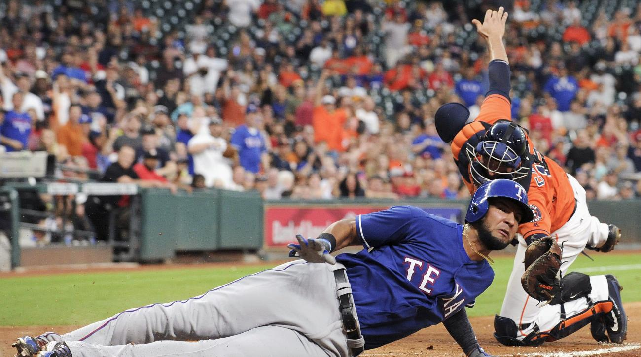 Texas Rangers' Nomar Mazara, left, is tagged out at home by Houston Astros catcher Jason Castro in the fourth inning of a baseball game, Friday, May 20, 2016, in Houston. (AP Photo/Eric Christian Smith)