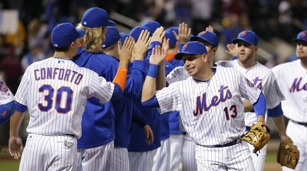 New York Mets' Michael Conforto (30) and Asdrubal Cabrera (13) celebrate with teammates after a baseball game against the Milwaukee Brewers on Friday, May 20, 2016, in New York. The Mets won 3-2. (AP Photo/Frank Franklin II)