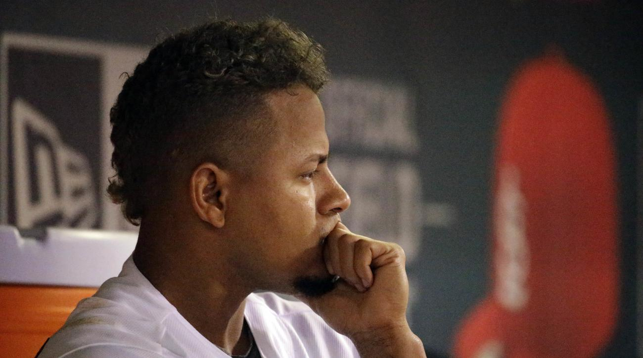 St. Louis Cardinals starting pitcher Carlos Martinez stands in the dugout after working during the fifth inning of a baseball game against the Arizona Diamondbacks Friday, May 20, 2016, in St. Louis. (AP Photo/Jeff Roberson)