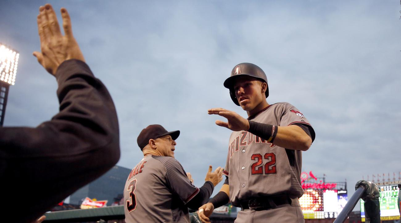 Arizona Diamondbacks' Jake Lamb, right, is congratulated by teammates including manager Chip Hale (3) after scoring during the first inning of a baseball game against the St. Louis Cardinals Friday, May 20, 2016, in St. Louis. (AP Photo/Jeff Roberson)