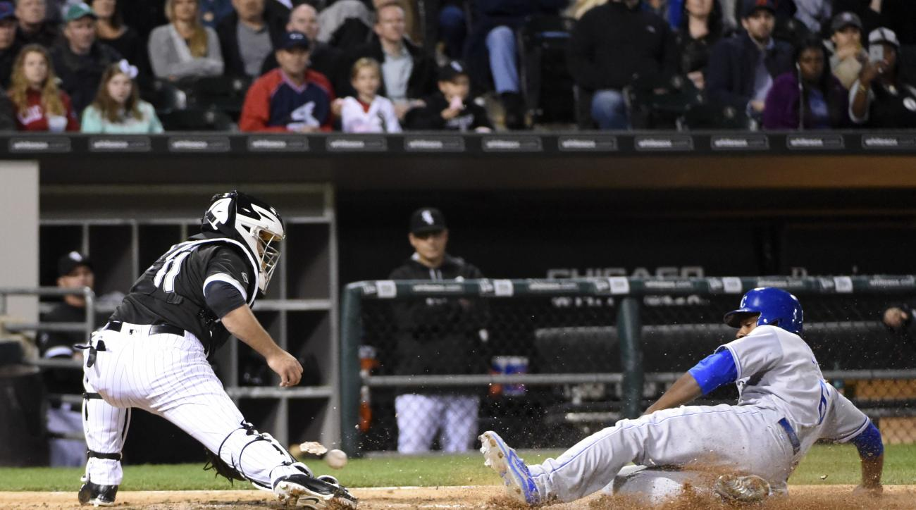 Kansas City Royals' Lorenzo Cain (6) is safe at home as Chicago White Sox catcher Alex Avila (31) prepares to make a tag during the sixth inning of a baseball game, Friday, May 20, 2016, in Chicago. (AP Photo/David Banks)
