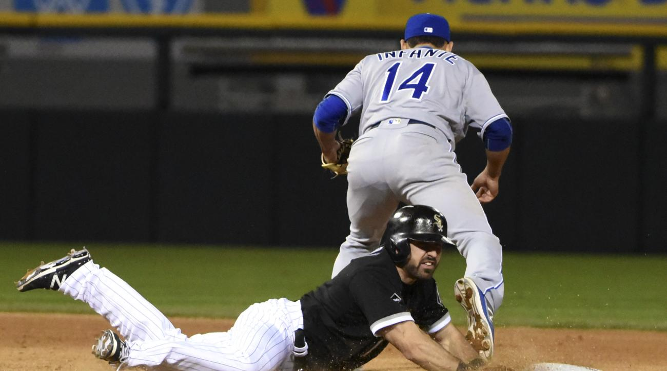 Chicago White Sox's Adam Eaton (1) is forced out into a double play at second base by Kansas City Royals second baseman Omar Infante (14) during the seventh inning of a baseball game, Friday, May 20, 2016, in Chicago. (AP Photo/David Banks)