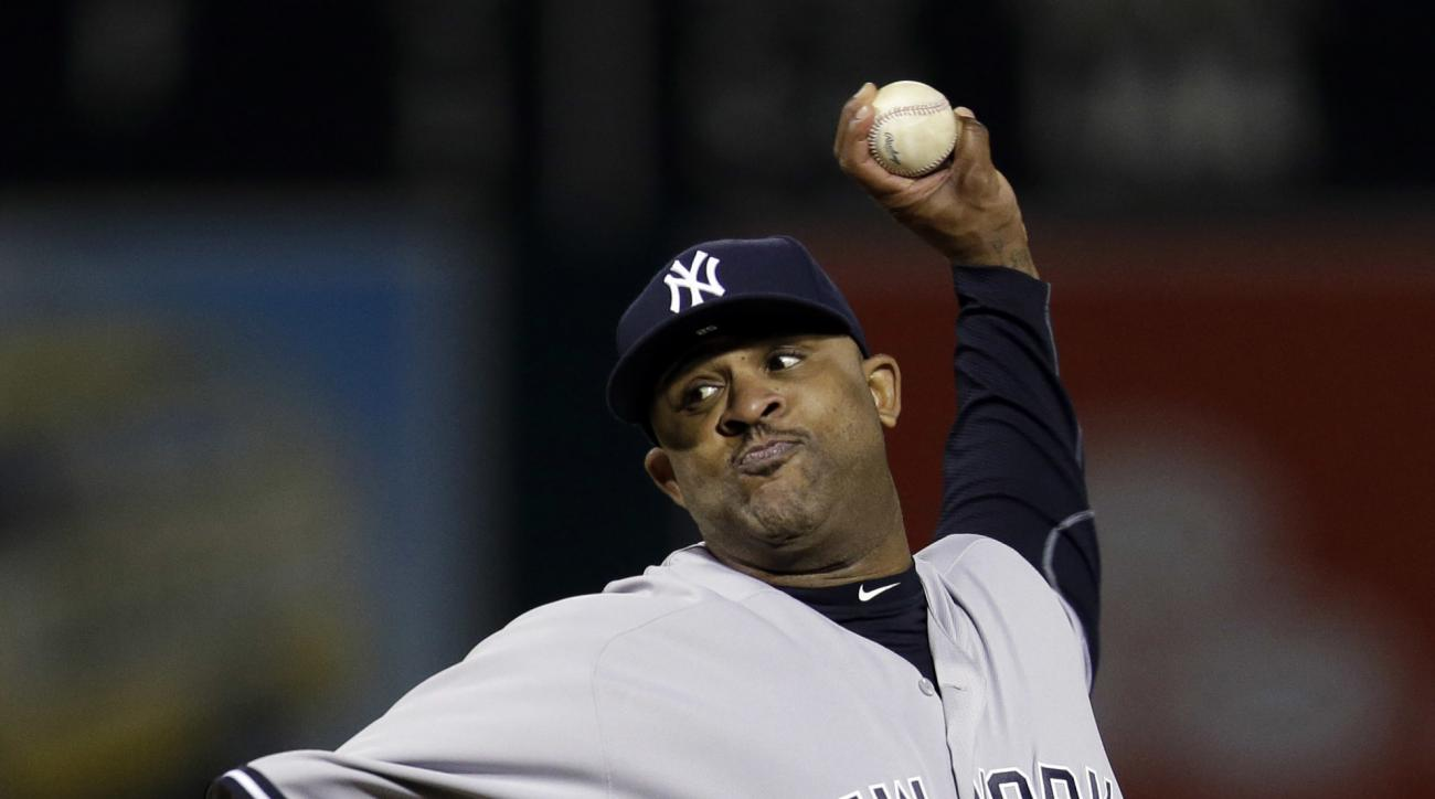New York Yankees starting pitcher CC Sabathia throws to the Oakland Athletics during the sixth inning of a baseball game Friday, May 20, 2016, in Oakland, Calif. (AP Photo/Marcio Jose Sanchez)