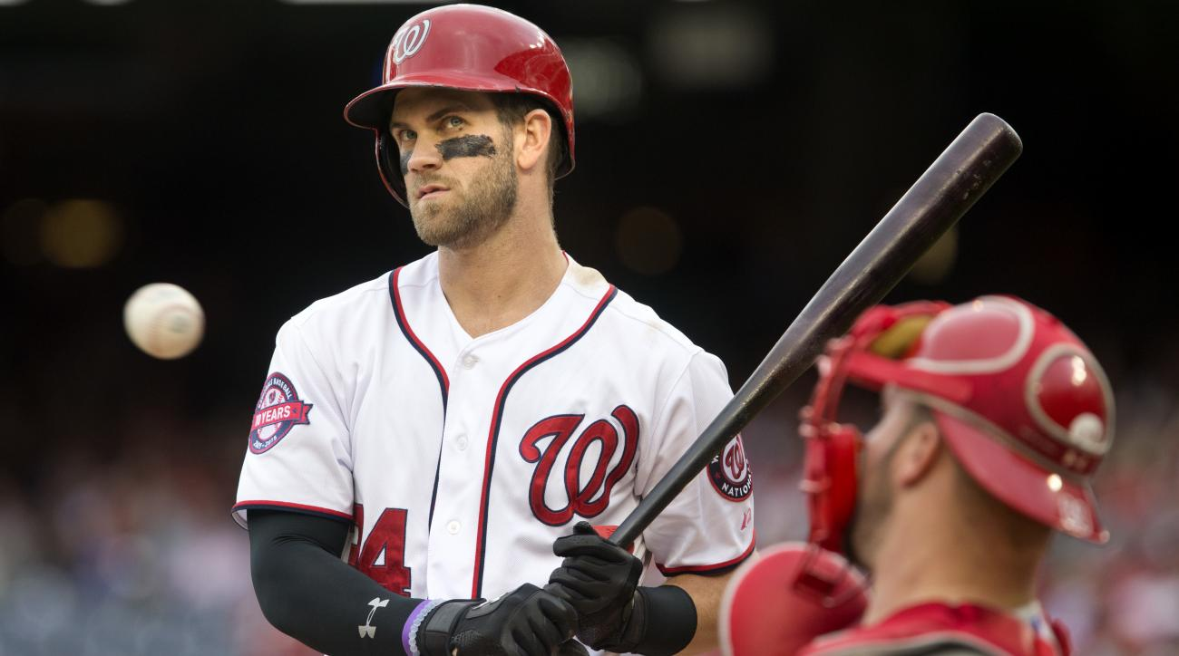FILE - In this Sept. 27, 2015 file photo, Washington Nationals' Bryce Harper (34) waits as the catcher returns the ball during batting in the eighth inning of a baseball game against the Philadelphia Phillies at Nationals Park in Washington on Sunday, Sep