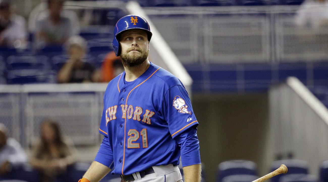 FILE - In this Sept. 2, 2014, file photo, New York Mets' Lucas Duda walks to the dugout after striking out during a baseball game against the Miami Marlins in Miami. Duda is out of the lineup again on Saturday, May 21, 2016, with a bad back, and the Mets