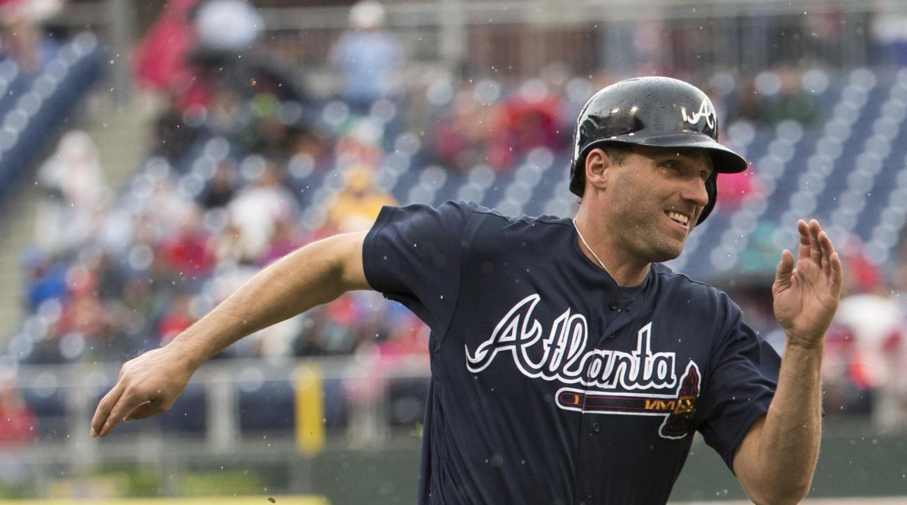 Atlanta Braves' Jeff Francoeur runs home to score on a double by Ender Inciarte during the fourth inning of a baseball game, Saturday, May 21, 2016, in Philadelphia. (AP Photo/Chris Szagola)