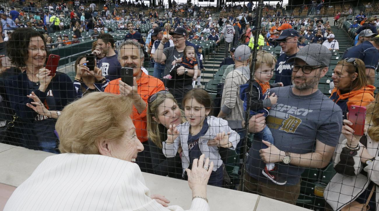 Hermina Hirsch, 89, a Holocaust survivor, greets relatives after singing the national anthem before the baseball game between the Detroit Tigers and the Tampa Bay Rays, Saturday, May 21, 2016, in Detroit. Hirsch's bucket list included singing the anthem b