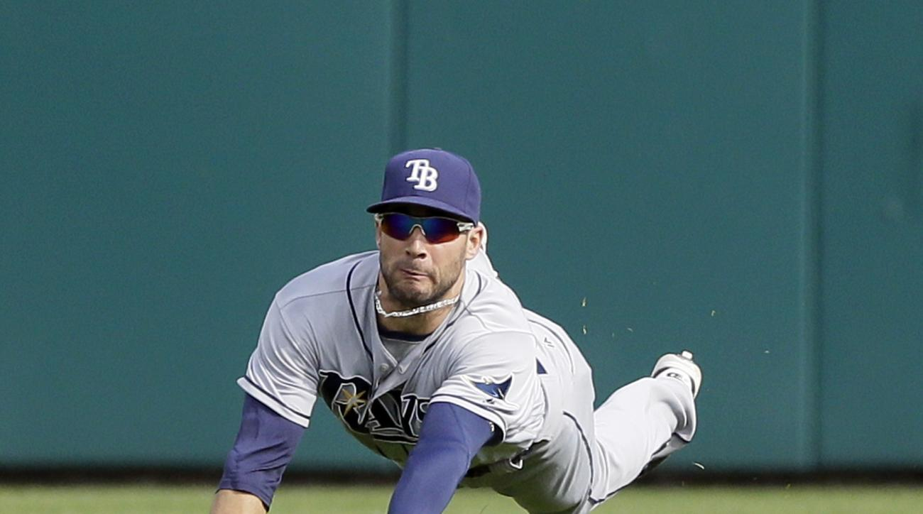 Tampa Bay Rays center fielder Kevin Kiermaier falls on his left wrist after diving for the single hit by Detroit Tigers' James McCann during the fifth inning of a baseball game, Saturday, May 21, 2016, in Detroit. (AP Photo/Carlos Osorio)