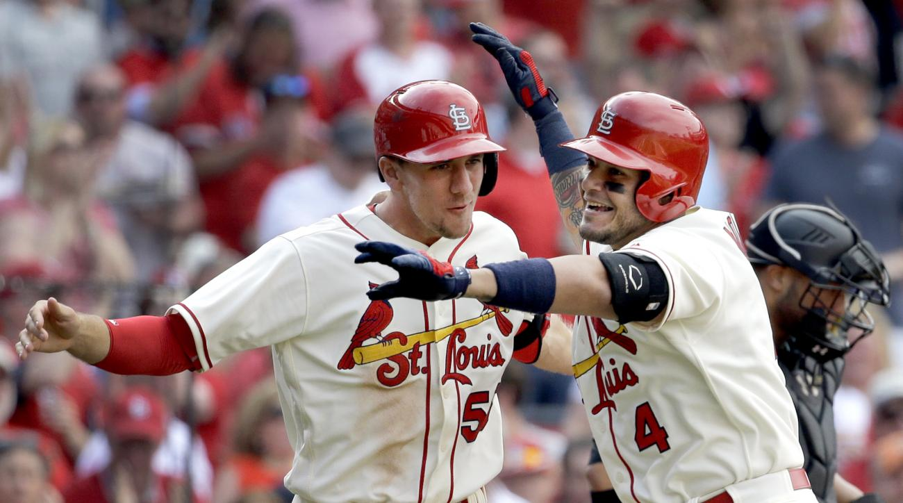 St. Louis Cardinals' Yadier Molina, right, is congratulated by teammate Stephen Piscotty after hitting a two-run home run during the seventh inning of a baseball game against the Arizona Diamondbacks, Saturday, May 21, 2016, in St. Louis. (AP Photo/Jeff R