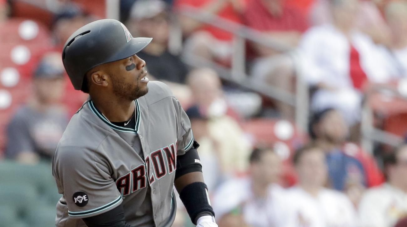 Arizona Diamondbacks' Rickie Weeks watches his two-run home run during the ninth inning of a baseball game against the St. Louis Cardinals Saturday, May 21, 2016, in St. Louis. (AP Photo/Jeff Roberson)