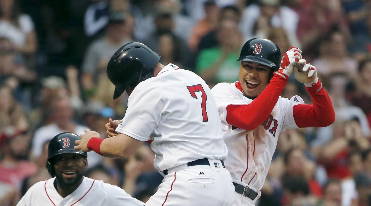 Boston Red Sox's Mookie Betts, right, celebrates his grand slam that also drove in Christian Vazquez (7) and Jackie Bradley Jr., left, during the seventh inning of a baseball game against the Cleveland Indians in Boston, Saturday, May 21, 2016. (AP Photo/