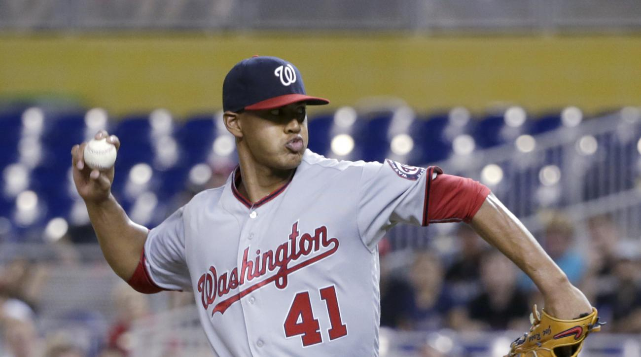 Washington Nationals' Joe Ross delivers a pitch during the first inning of a baseball game against the Miami Marlins, Saturday, May 21, 2016, in Miami. (AP Photo/Wilfredo Lee)