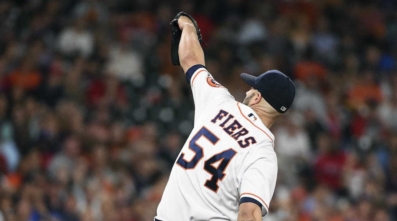Houston Astros starting pitcher Mike Fiers winds up during the sixth inning of a baseball game against the Texas Rangers, Saturday, May 21, 2016, in Houston. (AP Photo/Eric Christian Smith)