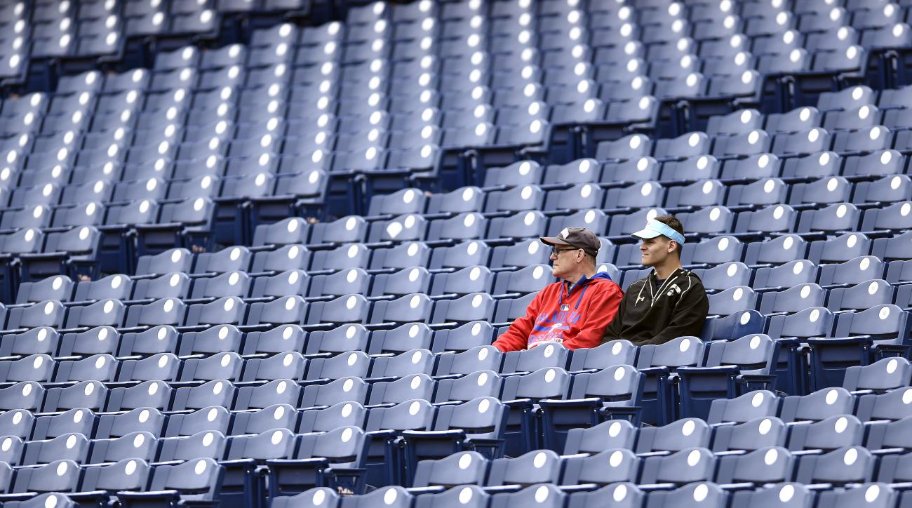 Fans sit before a baseball game between the Philadelphia Phillies and the Atlanta Braves on Sunday, May 22, 2016, in Philadelphia. (AP Photo/Michael Perez)