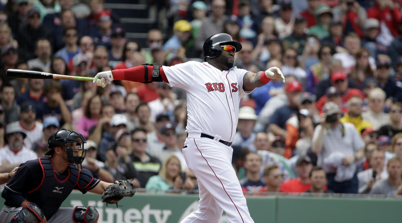 Boston Red Sox's David Ortiz, right, hits a ground-rule double as Cleveland Indians' Yan Gomes, left, looks on in the second inning of a baseball game at Fenway Park, Sunday, May 22, 2016, in Boston. (AP Photo/Steven Senne)