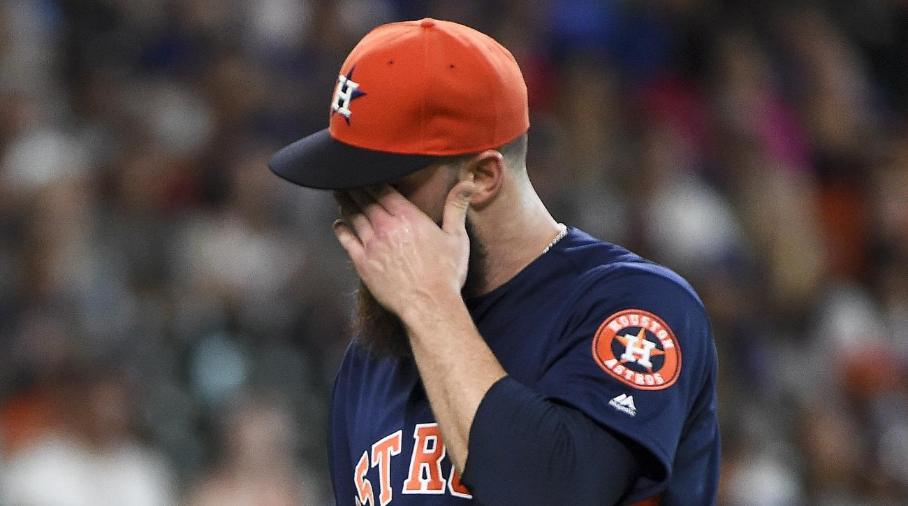 Houston Astros starting pitcher Dallas Keuchel walks to the dugout after completing the fourth inning of a baseball game against the Texas Rangers, Sunday, May 22, 2016, in Houston. (AP Photo/Eric Christian Smith)