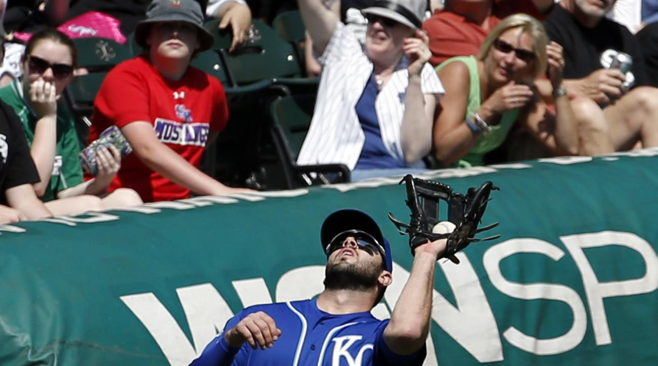 Kansas City Royals third baseman Mike Moustakas catches a foul ball hit by Chicago White Sox's Brett Lawrie during the fourth inning of a baseball game Sunday, May 22, 2016, in Chicago. (AP Photo/Nam Y. Huh)