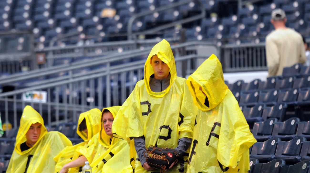 Fans wait during a rain delay at a baseball game between the Pittsburgh Pirates and the Colorado Rockies, Sunday, May 22, 2016, in Pittsburgh. (AP Photo/John Heller)