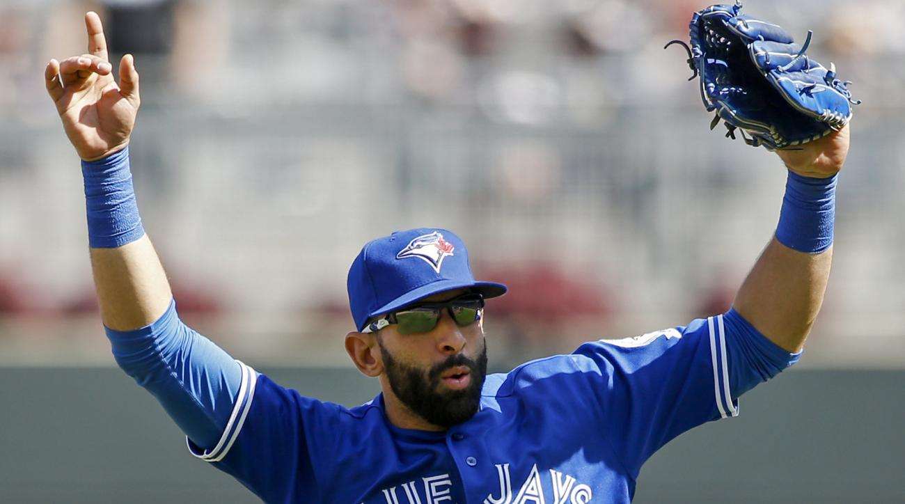 Toronto Blue Jays right fielder Jose Bautista celebrates a win over the Minnesota Twins at a baseball game Sunday, May 22, 2016, in Minneapolis. (AP Photo/Bruce Kluckhohn)