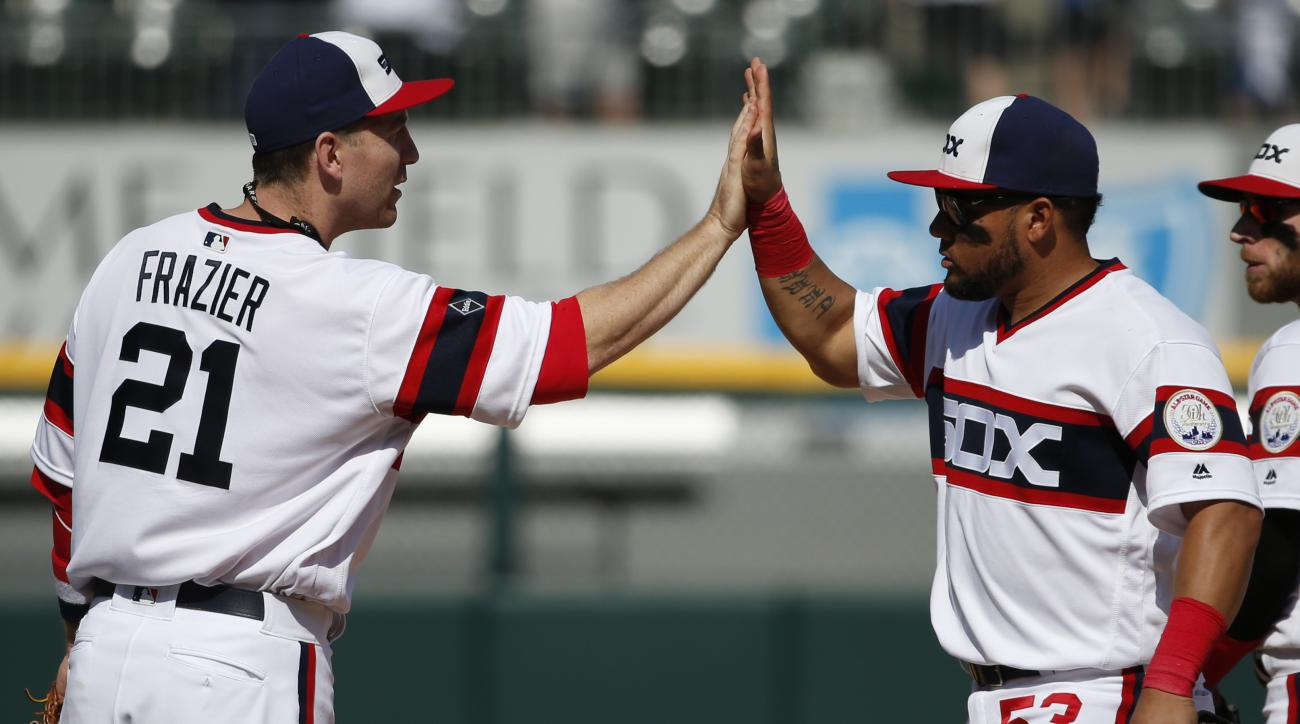 Chicago White Sox's Melky Cabrera, right, celebrates with Todd Frazier after they defeated the Kansas City Royals in a baseball game Sunday, May 22, 2016, in Chicago. (AP Photo/Nam Y. Huh)