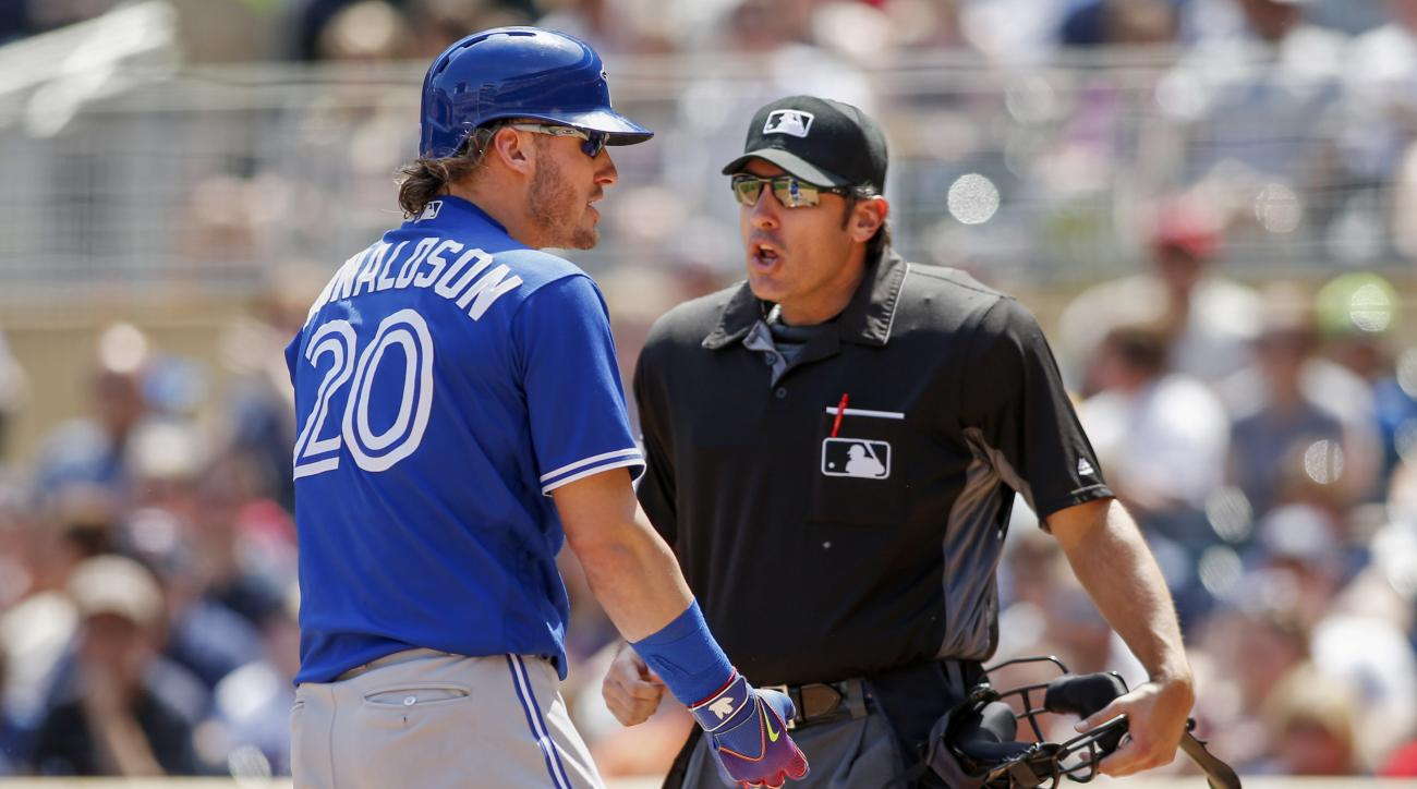 Toronto Blue Jays third baseman Josh Donaldson, left, argues with umpire Mark Ripperger about a close pitch by the Minnesota Twins in the fifth inning of a baseball game Sunday, May 22, 2016, in Minneapolis. (AP Photo/Bruce Kluckhohn)