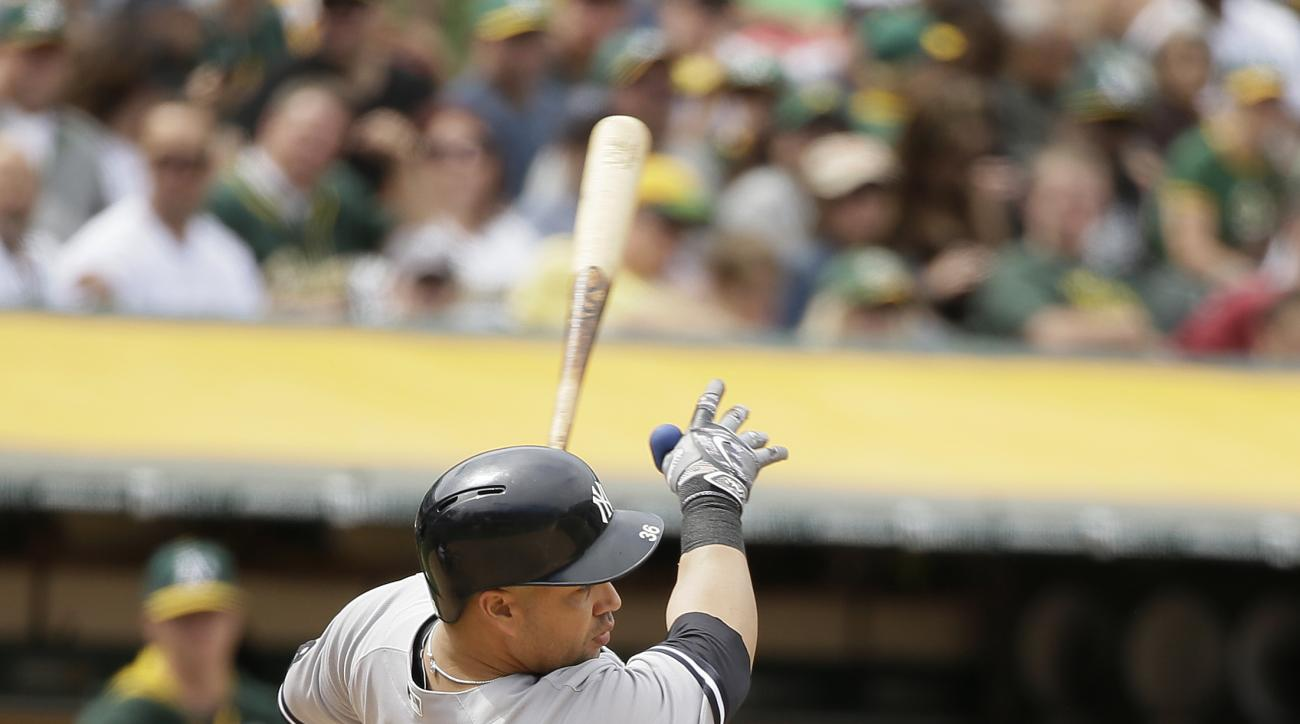 New York Yankees' Carlos Beltran hits an RBI-double to left field off Oakland Athletics relief pitcher Sean Doolittle in the seventh inning of a baseball game Sunday, May 22, 2016, in Oakland, Calif. (AP Photo/Eric Risberg)