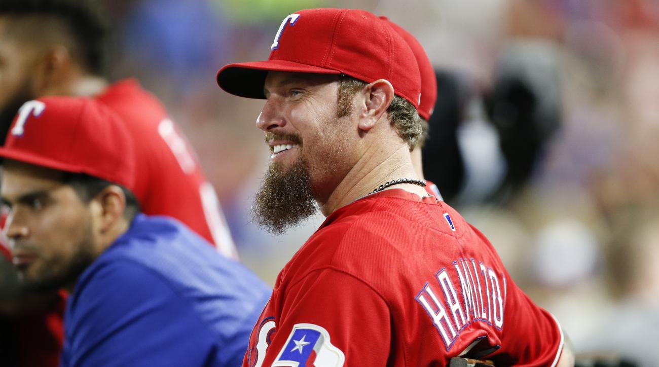 Texas Rangers' Josh Hamilton watches from the bench during the fifth inning of a baseball game against the Baltimore Orioles, Saturday, April 16, 2016, in Arlington, Texas. (AP Photo/Jim Cowsert)