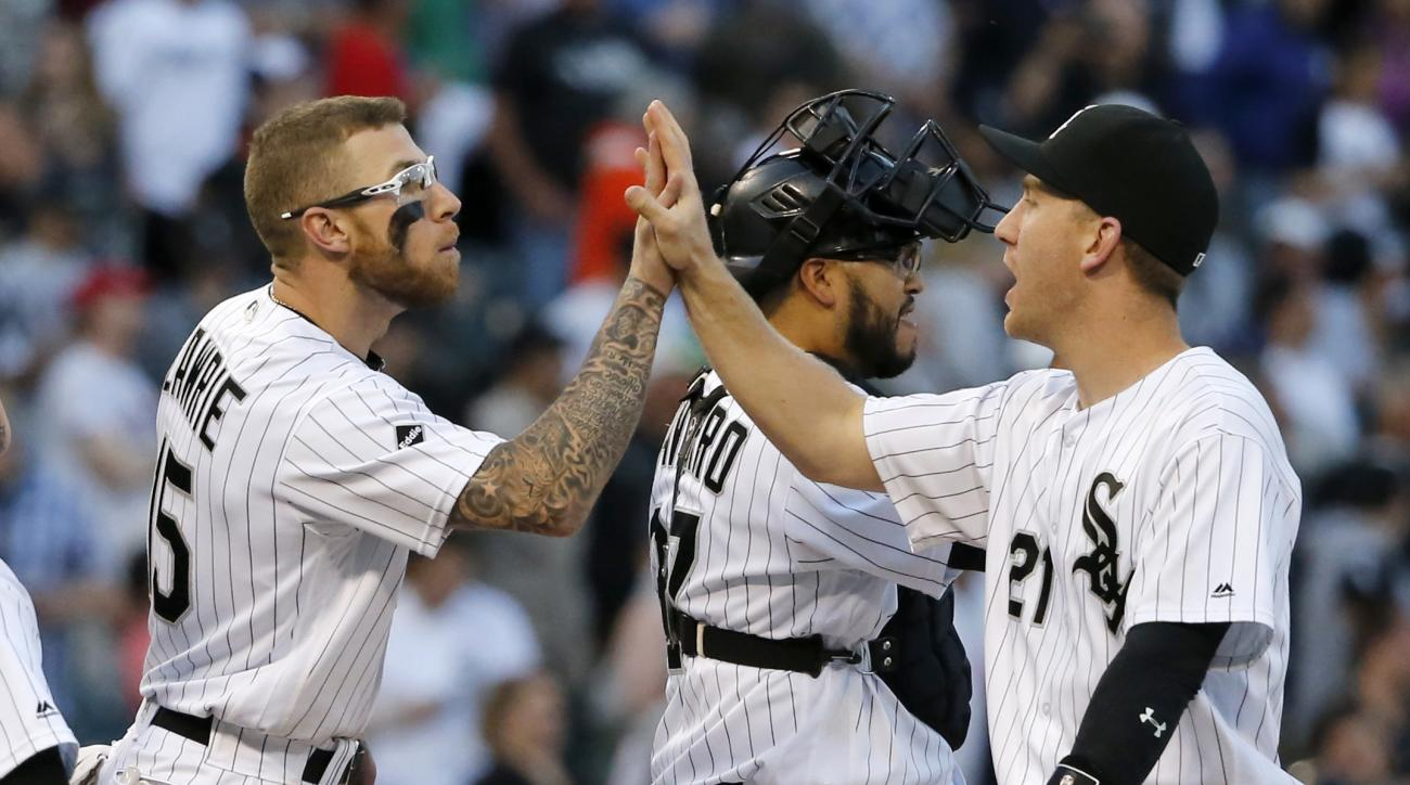 Chicago White Sox's Brett Lawrie, left, and Todd Frazier celebrate the White Sox's 7-6 win over the Cleveland Indians after a baseball game, the first of a double-header, Monday, May 23, 2016, in Chicago. (AP Photo/Charles Rex Arbogast)