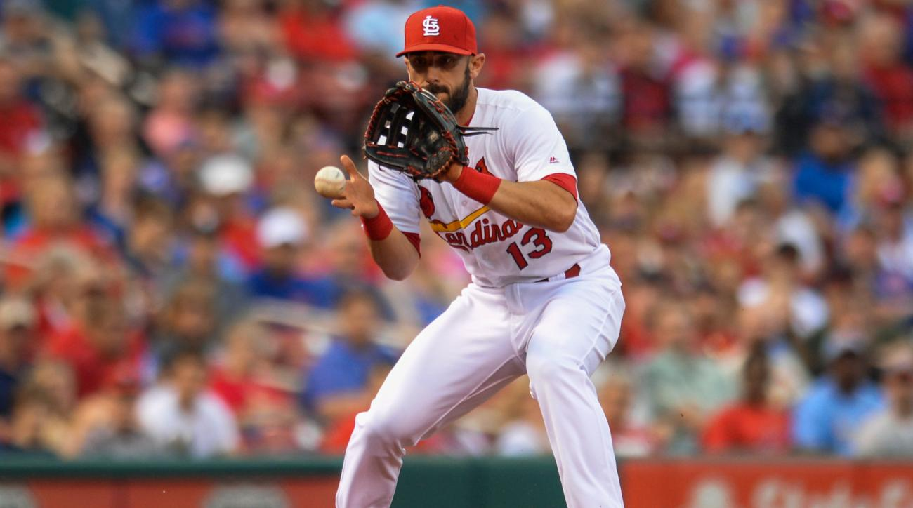 St. Louis Cardinals' third baseman Matt Carpenter (13) fields a ball against the Chicago Cubs in the second inning of a baseball game Monday, May 23, 2016, in St. Louis. (AP Photo/Michael Thomas)