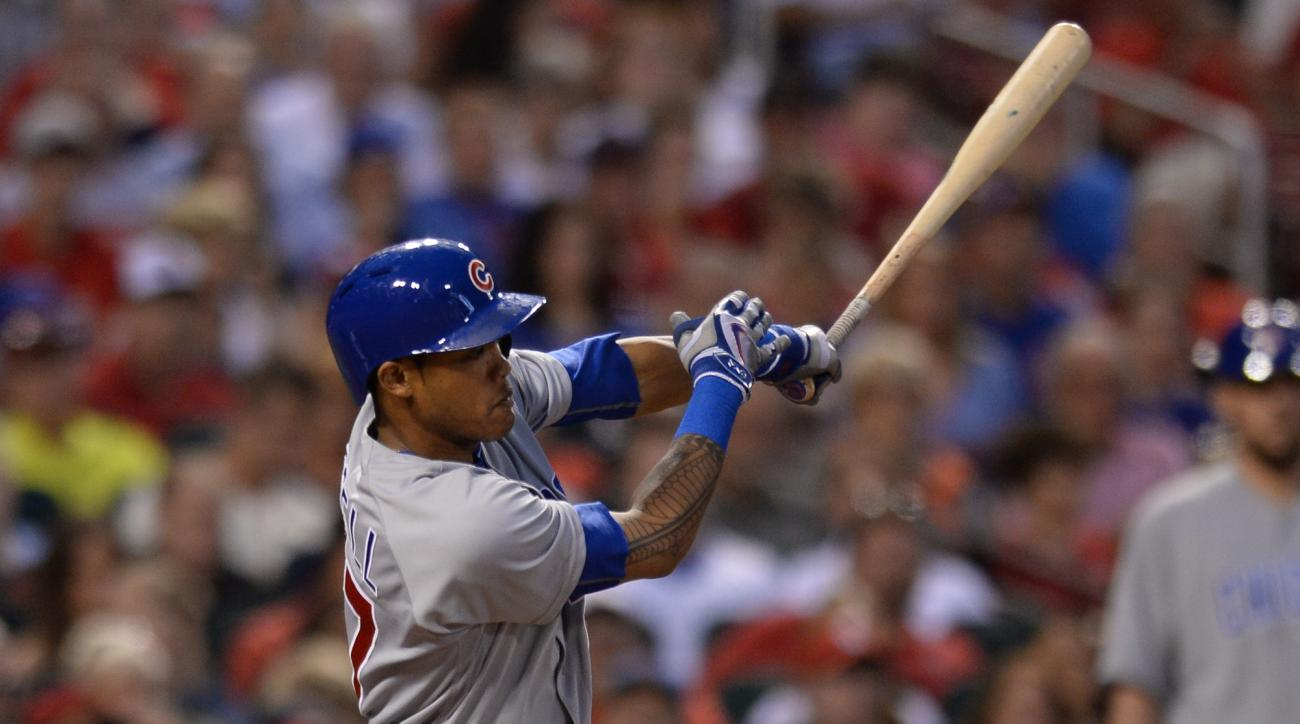Chicago Cubs' Addison Russell (27) hits an RBI-single against the St. Louis Cardinals in the fourth inning of a baseball game Monday, May 23, 2016, in St. Louis. (AP Photo/Michael Thomas)