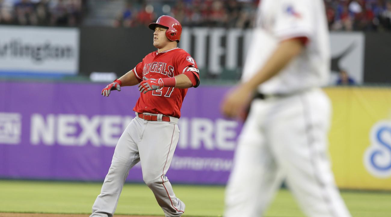 Los Angeles Angels Mike Trout (27) turns on second base after hitting a double during the second inning of a baseball game against the Texas Rangers in Arlington, Texas, Monday, May 23, 2016. (AP Photo/LM Otero)